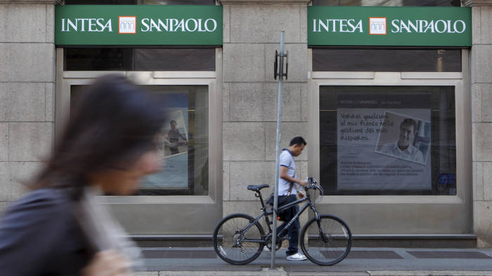 People walk past an Intesa Sanpaolo bank branch in Milan, Italy,Thursday, Sept. 22, 2011. Standard & Poor's said Wednesday that it had downgraded seven Italian banks because of sovereign debt risk, a day after the agency downgraded Italy's credit rating. The cut targeted leading banks Mediobanca SpA and Intesa Sanpaolo SpA, as well as Findomestic Banca SpA, Banca IMI SpA, Banca Nazionale del Lavoro SpA, Banca Infrastrutture Innovazione e Sviluppo SpA and Cassa di Risparmio in Bologna SpA. The agency said it was assigning negative outlooks to the long-term ratings on these seven banks. (AP Photo/Luca Bruno)