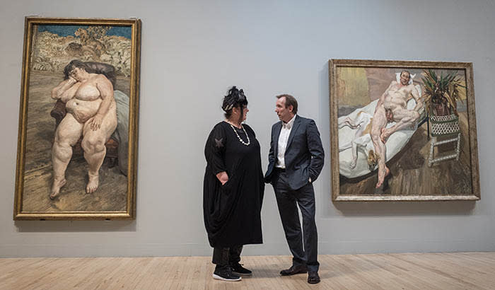 "26/02/2018 A photo call for the opening of the Tate Britain exhibition ""All too human"". Pictures shows visitors looking at works this morning. Picture shows Sue Tilley and David Dawson in front of their portraits entitled 'Sleeping by the Lion Carpet' (left) and 'David and Eli', by Lucian Freud"