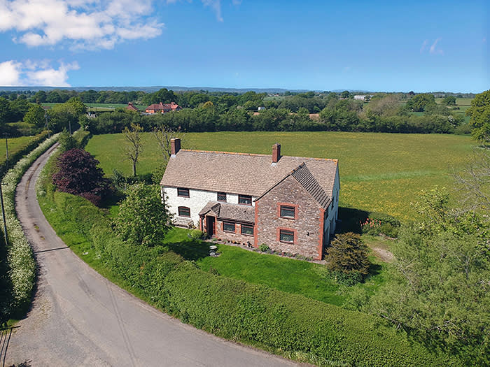 Drone photograph of a period cottage on a country lane between Bristol and Gloucester, £675,000 through Knight Frank
