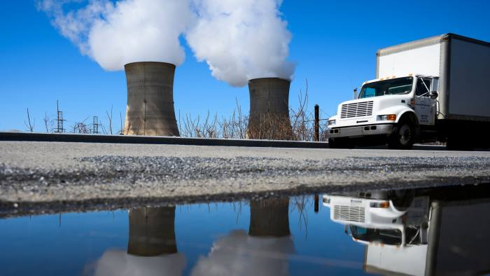 A car drives past the nuclear plant on Three Mile Island, with the operational plant run by Exelon Generation on the right, in Middletown, Pennsylvania on March 26, 2019. (Photo by ANDREW CABALLERO-REYNOLDS / AFP) (Photo credit should read ANDREW CABALLERO-REYNOLDS/AFP via Getty Images)