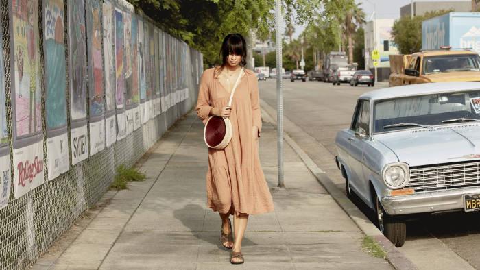 Model wears Lugano nubuck leather sandals by Birkenstock