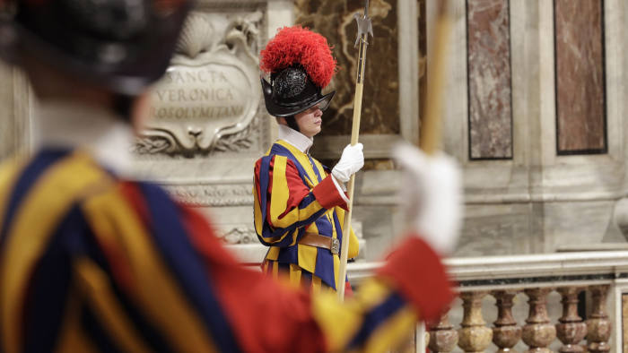 Swiss guards stand attention as Pope Francis presides over a Mass for the World Missionary Day, in St. Peter's Basilica at the Vatican, Sunday, Oct. 20, 2019. (AP Photo/Andrew Medichini)