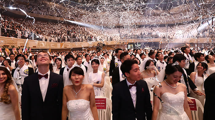 ***BESTPIX*** GAPYEONG-GUN, SOUTH KOREA - AUGUST 27: Thousands of couples attend a mass wedding held by the Family Federation for World Peace and Unification, aka Unification Church on August 27, 2018 in Gapyeong-gun, South Korea. Some 4,000 'Moonies', believers of Unification Church, which was named after the founder Moon Sun Myung, attend the mass wedding which began in the early 1960s. (Photo by Chung Sung-Jun/Getty Images)