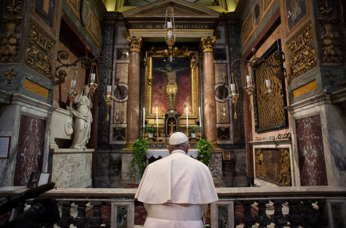 Pope Francis prays at San Marcello al Corso church for the end of the coronavirus pandemic, in Rome, Italy March 15, 2020. Vatican Media/Handout via REUTERS ATTENTION EDITORS - THIS IMAGE WAS PROVIDED BY A THIRD PARTY.