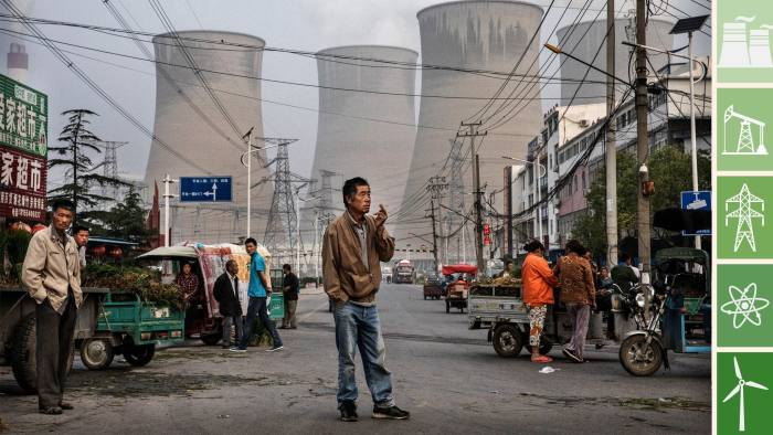 HUAINAN, CHINA - JUNE 14: Chinese street vendors and customers gather at a local market outside a state owned Coal fired power plant near the site of a large floating solar farm project under construction by the Sungrow Power Supply Company on a lake caused by a collapsed and flooded coal mine on June 14, 2017 in Huainan, Anhui province, China. The floating solar field, billed as the largest in the world, is built on a part of the collapsed Panji No.1 coal mine that flooded over a decade ago due to over-mining, a common occurence in deep-well mining in China's coal heartland. When finished, the solar farm will be made up of more than 166,000 solar panels which convert sunlight to energy, and the site could potentially produce enough energy to power a city in Anhui province, regarded as one of the country's coal centers. Local officials say they are planning more projects like it, marking a significant shift in an area where long-term intensive coal mining has led to large areas of subsidence and environmental degradation. However, the energy transition has its challenges, primarily competitive pressure from the deeply-established coal industry that has at times led to delays in connecting solar projects to the state grid. Chinaâs government says it will spend over US $360 billion on clean energy projects by 2020 to help shift the country away from a dependence on fossil fuels, and earlier this year, Beijing canceled plans to build more than 100 coal-fired plants in a bid to ease overcapacity and limit carbon emissions. Already, China is the leading producer of solar energy, but it also remains the planetâs top emitter of greenhouse gases and accounts for about half of the worldâs total coal consumption. (Photo by Kevin Frayer/Getty Images)