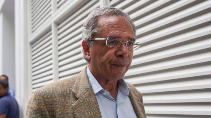 "Brazilian Economist Paulo Guedes walks after speaking to the press outside Brazilian businessman Paulo Marinho's home, where Brazilian president-elect Jair Bolsonaro held a meeting, in Rio de Janeiro, Brazil, on October 30, 2018. - Brazil's far-right President-elect Jair Bolsonaro huddled with advisers Tuesday to finalize the cabinet that will be charged with implementing his hardline agenda, as opponents planned their ""resistance."" (Photo by Mauro Pimentel / AFP)MAURO PIMENTEL/AFP/Getty Images"
