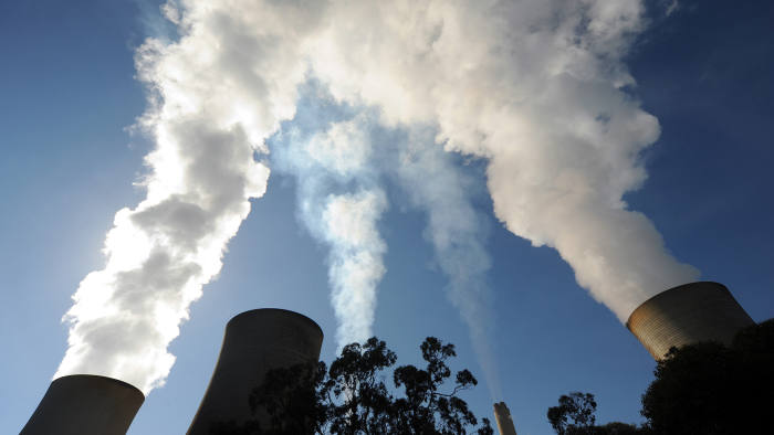 Steam billows from the cooling towers of a coal-fired power station in Australia. Photographer: Carla Gottgens/Bloomberg