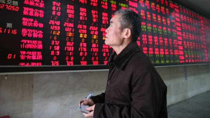 epa05027713 A stock investor watches stock prices in front of an electronic screen showing the stock prices at a brokerage house in Beijing, China, 16 November 2015. Stocks across Asia were down Monday in the first day of trading after the Paris terrorist attacks which left about 130 people dead. The Shanghai composite index opened down at 3,522.46 and closed at 3606.96, rose 0.73 percent. The Shenzhen composite index opened down at 12,180.99 and closed at 12,620.38, rose 1.76 percent. EPA/WU HONG