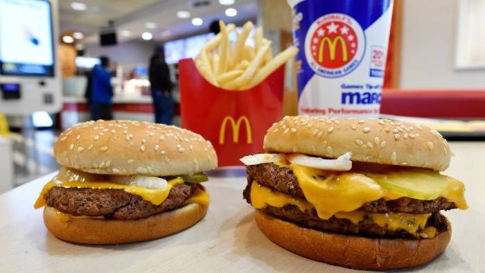 FILE- In this March 6, 2018, file photo, a McDonald's Quarter Pounder, left, and Double Quarter Pound burger is shown with fresh beef in Atlanta. McDonald's Corp. reports earnings Monday, April 30. (AP Photo/Mike Stewart, File)