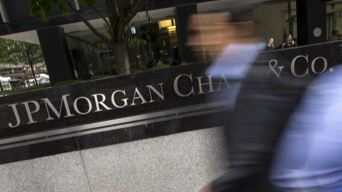 People pass the JP Morgan Chase & Co. Corporate headquarters in the Manhattan borough of New York City, May 20, 2015. A U.S. regulator has granted waivers to JPMorgan Chase & Co and four other major banks allowing them to continue their usual securities business, after they agreed to plead guilty to criminal charges, according to a person familiar with the matter. The regulator, the Securities and Exchange Commission, is expected to publicly confirm the waivers will be in place once the banks formally enter guilty pleas, and the announcement could come by the end of the day Wednesday, two other sources told Reuters. REUTERS/Mike Segar - GF10000101443