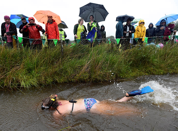 A competitor takes part in the World Bog Snorkelling Championships in Waen Rhydd peat bog at Llanwrtyd Wells in Wales, Britain August 26, 2018. REUTERS/Rebecca Naden TPX IMAGES OF THE DAY