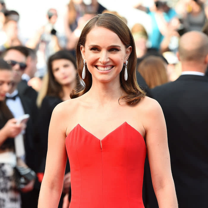 US-Israeli actress and director Natalie Portman smiles as she arrives for the opening ceremony of the 68th Cannes Film Festival in Cannes, southeastern France, on May 13, 2015. AFP PHOTO / ANNE-CHRISTINE POUJOULAT (Photo credit should read ANNE-CHRISTINE POUJOULAT/AFP/Getty Images)