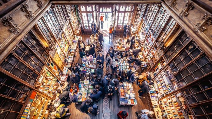 Porto, Portugal - November 13, 2017: Customers and tourists in famous Lello Bookstore in Porto, considered to be one of the most beautiful bookstores in the world