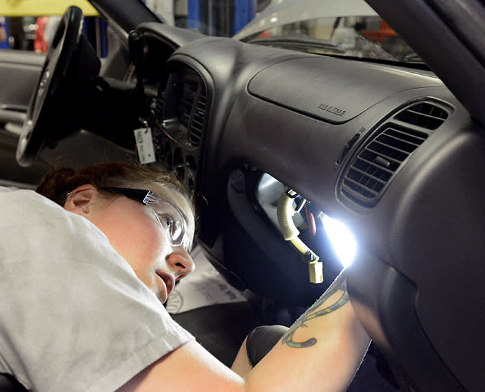 TOPSHAM, ME - May 21: Japanese auto supplier Takata has issued recalls for 34 million airbags. Auto tech Becky McInnis reinstalls a airbag after changing the inflator module on this 03 Toyota Tundra at Lee Toyota in Topsham. (Photo by John Patriquin/Portland Press Herald via Getty Images)