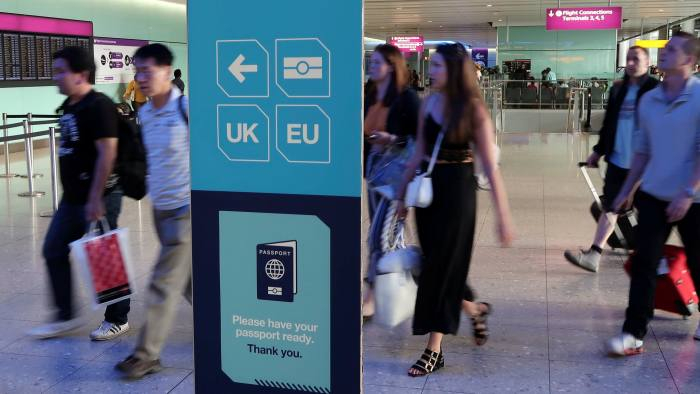 Passengers walk towards the UK Border control in Terminal 2 at Heathrow Airport in London, Britain, July 30, 2017. REUTERS/Fabrizio Bensch - RC1CABF58700