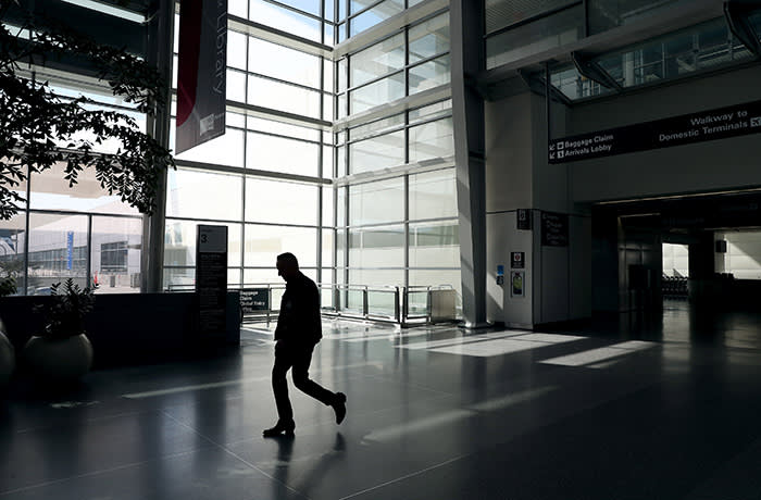 A man passed through an empty San Francisco International Airport in San Francisco, California on Tuesday April 7, 2020. Air traffic was virtually stalled due to the coronavirus pandemic. (Jane Tyska / Digital First Media / East Bay Times via Getty Images)
