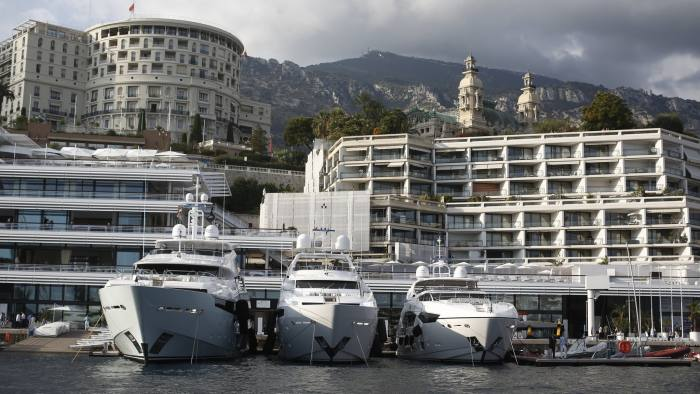Luxury yachts Blush, left, Thumper, center, and Zozo, built by Sunseeker International Ltd., a unit of Dalian Wanda Group, sit moored in the harbor during the Monaco Yacht Show (MYS) in Monaco, France, on Thursday, Sept. 25, 2014. Over 100 of the world's most luxurious yachts will be displayed in Port Hercules during the 24th MYS which runs from Sept. 24 - 27. Photographer: Simon Dawson/Bloomberg