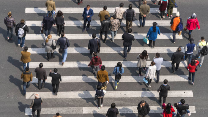 Aerial view of people on busy pedestrian crossing, Shanghai, China
