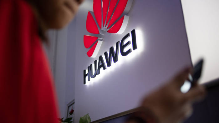 In this photo taken on May 27, 2019, a Huawei logo is displayed at a retail store in Beijing. - China is digging in for a tough period of deteriorating ties with the United States, fanning the flames of patriotism with Korean War films, a viral song on the trade war, and editorials lambasting Washington. (Photo by Fred DUFOUR / AFP) (Photo credit should read FRED DUFOUR/AFP via Getty Images)