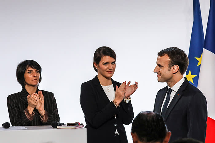 (Left to right) French patron of Women Safe Florence Foresti, with French minister for equality Marlene Schiappa and French President Emmanuel Macron / AFP PHOTO / POOL / LUDOVIC MARIN (Photo credit should read LUDOVIC MARIN/AFP/Getty Images)