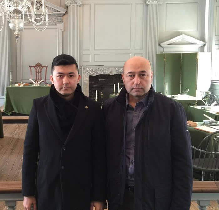 Kamaltürk Yalqun, left, with his father Yalqun Rozi, a prominent writer. In October 2016, he rang his father for a chat: 'It's not a good time. I'm about to be taken away,' Rozi said