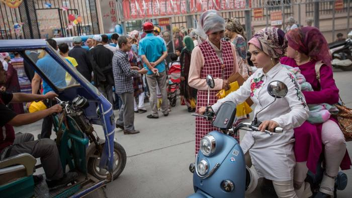 KASHGAR, CHINA - JULY 06: Uighur people pick up their kids from school in Kashgar City, northwest China's Xinjiang Uyghur Autonomous Region in China on July 06, 2017. (Photo by Stringer/Anadolu Agency/Getty Images)