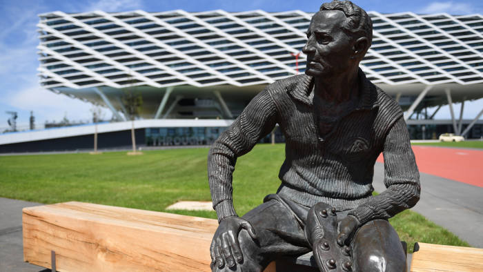 A statue depicting Adidas' founder Adolf Dassler is pictured in front of the Arena building during celebrations for German sports apparel maker Adidas' 70th anniversary at the company's headquarters in Herzogenaurach, Germany, August 9, 2019. REUTERS/Andreas Gebert