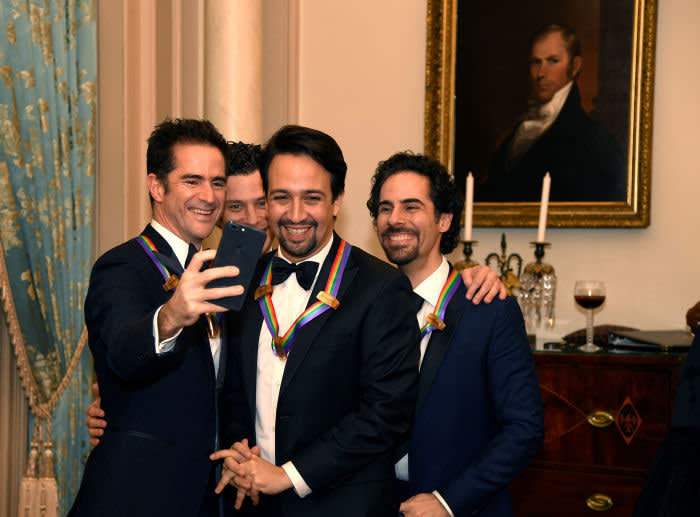 """2018 Kennedy Center Honorees team members of the Broadway play """"Hamilton"""" (L-R) Andy Blakenbuehler, Thomas Kail (hidden), Lin-Manuel Miranda and Alex Lacamoire take a """"selfie"""" at the conclusion of a gala dinner at the U.S. State Department, in Washington, U.S., December 1, 2018. REUTERS/Mike Theiler - RC1CA2A88B10"""
