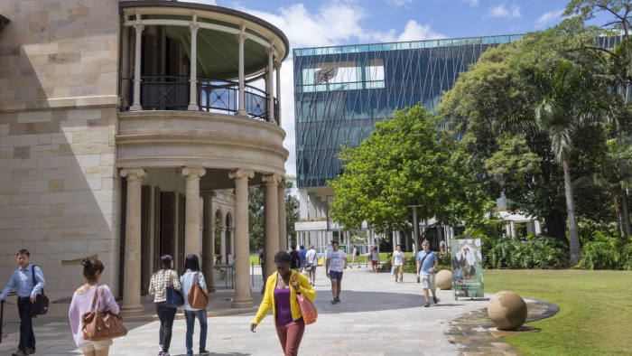 Australia, Queensland, Brisbane Central Business District, QUT Queensland University of Technology Garden Point campus student walking Black woman Old Government House Student Centre Science and Engineering. (Photo by: Jeff Greenberg/Universal Images Group via Getty Images)