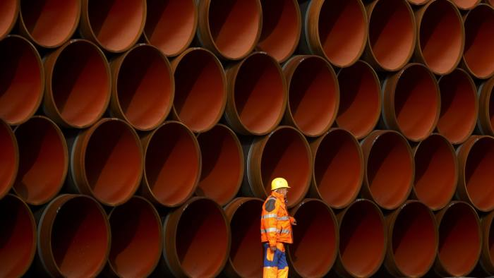 SASSNITZ, GERMANY - OCTOBER 19: A worker walks in front of pipes which lie stacked at the Nord Stream 2 facility at Mukran on Ruegen Islandon October 19, 2017 in Sassnitz, Germany. Nord Stream is laying a second pair of offshore pipelines in the Baltic Sea between Vyborg in Russia and Greifswald in Germany for the transportation of Russian natural gas to western Europe. An initial pair of pipelines was inaugurated in 2012 and the second pair is due for completion by 2019. A total of 50,000 pipes are currently on hand at Mukran, where they receive a concrete wrapping before being transported out to sea. Russian energy supplier Gazprom, whose board is led by former German chancellor Gerhard Schroeder, owns a 51% stake in Nord Stream. (Photo by Carsten Koall/Getty Images)