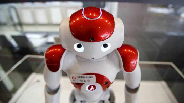 """""""Nao"""", a humanoid robot by Aldebaran Robotics that offers basic service information, is displayed in front of a branch of the Bank of Tokyo-Mitsubishi UFJ (MUFG) during a media preview at Narita International airport near Tokyo, Japan, March 25, 2016. REUTERS/Yuya Shino - GF10000359844"""