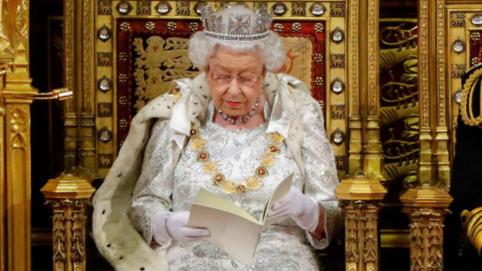Britain's Queen Elizabeth II (CL) reads the Queen's Speech on the The Sovereign's Throne in the House of Lords next to Britain's Prince Charles, Prince of Wales (CR) during the State Opening of Parliament in the Houses of Parliament in London on October 14, 2019. - The State Opening of Parliament is where Queen Elizabeth II performs her ceremonial duty of informing parliament about the government's agenda for the coming year in a Queen's Speech. (Photo by Tolga Akmen / POOL / AFP) (Photo by TOLGA AKMEN/POOL/AFP via Getty Images)