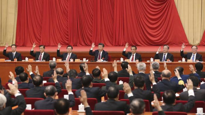 """In this photo released by Xinhua News Agency, members of the Politburo Standing Committee, on stage from left, Zhang Gaoli, Liu Yunshan, Zhang Dejiang, Chinese President Xi Jinping, Chinese Premier Li Keqiang, Yu Zhengsheng, and Wang Qishan attend the Sixth Plenary Session of the 18th CPC Central Committee held in Beijing on Thursday, Oct 27, 2016. China's Communist Party has elevated President Xi Jinping to the position of """"core"""" of the leadership, underscoring the overwhelming clout he has amassed on the back of a sweeping anti-corruption campaign and crackdown on dissent. (Pang Xinglei/Xinhua via AP)"""