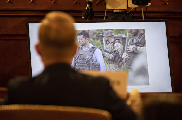 epa08015486 A photograph of Ukrainian President Volodymyr Zelensky is displayed on a television monitor past David Holmes, counselor for political affairs at the U.S. Embassy in Ukraine, during a House Intelligence Committee impeachment inquiry hearing in Washington, DC, USA, 21 November 2019. The impeachment inquiry is being led by three congressional committees and was launched following a whistleblower's complaint that alleges US President Donald J. Trump requested help from the President of Ukraine to investigate a political rival, Joe Biden and his son Hunter Biden. EPA-EFE/ANDREW HARRER / POOL
