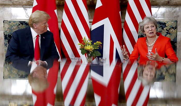 U.S. President Donald Trump, left, with British Prime Minister Theresa May, right, during their meeting at Chequers, in Buckinghamshire, England, Friday, July 13, 2018. (AP Photo/Pablo Martinez Monsivais)