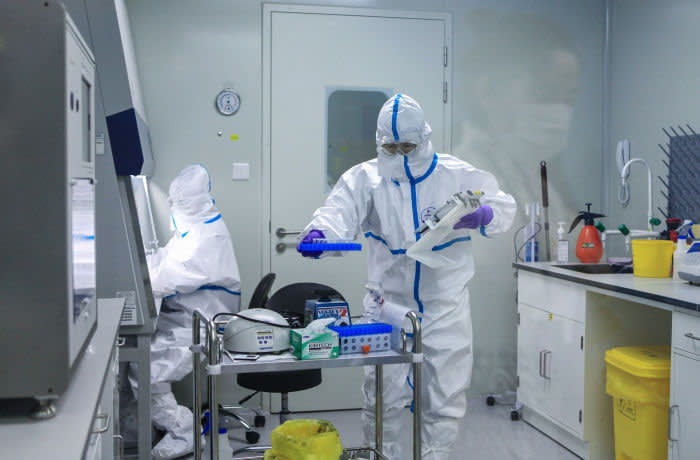 This photo taken on March 17, 2020 shows laboratory technicians working on testing samples from people to be tested for the COVID-19 coronavirus at a laboratory in Changzhou in China's eastern Jiangsu province. - China on March 19 marked a major milestone in its battle against the coronavirus pandemic as it recorded zero domestic infections for the first time since the outbreak emerged, but a spike in imported cases threatened its progress. (Photo by STR / AFP) / China OUT (Photo by STR/AFP via Getty Images)