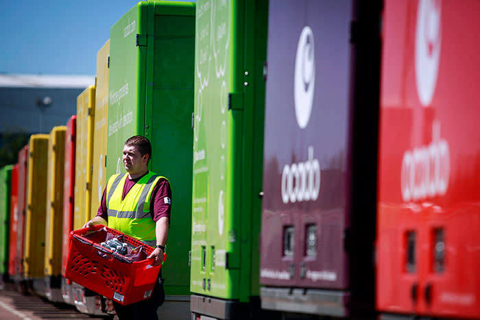 A driver checks his load before leaving to deliver orders at the Ocado Ltd. distribution center in Hatfield, UK. , on Wednesday, June 16, 2010. Ocado, the U.K. online grocer, will offer shares to customers in the event that it proceeds with plans for an initial public offering in London. Photographer: Jason Alden/Bloomberg