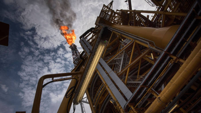 A view of the flare on the Kaombo Norte, a Floating Production Storage and Offloading vessel(FPSO), a project operated by Total, the French multinational oil company, on November 8, 2018, about 250km off the coast of Angola in the Atlantic Ocean. The flare is burning excess extracted that isn't used, but once the FPSO's gas system is fully operational, there will be very little or no flare. - A column of flame emanates from the bow of the boat, illuminating the jet-black ocean for miles around. For three months now the Kaombo Norte has been anchored off the northern coast of Angola and has recently begun to pump up crude oil secreted in the depths below. The arrival of the platform ship which belongs to French oil giant Total has been a timely lifeline for the Angolan government. (Photo by Rodger BOSCH / AFP) (Photo credit should read RODGER BOSCH/AFP/Getty Images)