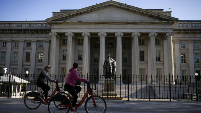Bicyclists pass the U.S. Treasury building in Washington, D.C., U.S., on Thursday, April 16, 2020. President Donald Trump threatened Wednesday to try to force both houses of Congress to adjourn -- an unprecedented move that would likely raise a constitutional challenge -- so that he can make appointments to government jobs without Senate approval. Photographer: Al Drago/Bloomberg