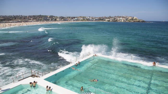 Bondi beach, Sydney, NSW, Australia - November 1, 2015: People swimming in the fresh water swimming pools built in to the sea with waves rolling in to Bondi and breaking against the edge of the pool Getty Images
