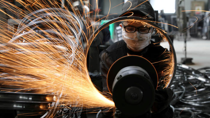 A worker welds a bicycle steel rim at a factory manufacturing sports equipment in Hangzhou, Zhejiang province, China September 2, 2019. Picture taken September 2, 2019. China Daily via REUTERS ATTENTION EDITORS - THIS IMAGE WAS PROVIDED BY A THIRD PARTY. CHINA OUT. TPX IMAGES OF THE DAY - RC173452F240