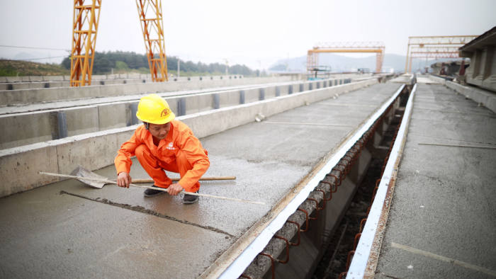 Mandatory Credit: Photo by Xinhua/Shutterstock (10609218g) 			A worker makes precast beam at a beam production site for the construction of a fast railway in Guiyang, southwest China's Guizhou Province, April 10, 2020. The construction of the southwest ring road fast railway in Guiyang has been resumed in an orderly manner under strict measures taken to fight against the COVID-19. 			China Guizhou Guiyang Railway Construction - 10 Apr 2020