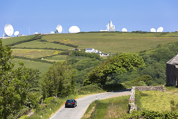 GCHQ's base in Bude, Cornwall, with its 29 satellites. An employee who maintains them says: 'While powerful satellites are slow to set up, expensive and difficult to maintain, they remain an important tool in GCHQ's arsenal'
