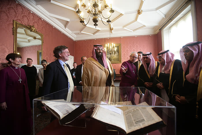 The Archbishop of Canterbury Justin Welby (centre right) accompanies the Crown Prince of Saudi Arabia, HRH Mohammed bin Salman (centre), as they view a selection of early texts from the Christian, Muslim and Jewish faiths from the Lambeth Palace library collection, at a private meeting at Lambeth Palace, London. PRESS ASSOCIATION Photo. Issue date: Thursday March 8, 2018. See PA story POLITICS Saudi. Photo credit should read: Yui Mok/PA Wire