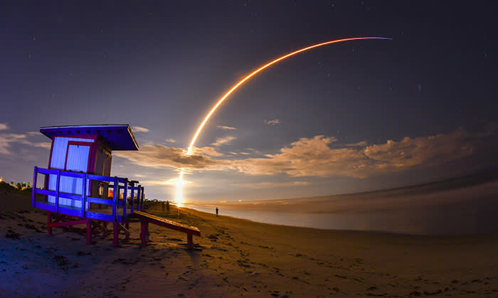 The launch of Telesat's Telstar 18 Vantage communications satellite on a SpaceX Falcon 9 rocket, launched from Launch Complex 40 at Cape Canaveral Air Force Station, is viewed from Minutemen Causeway in Cocoa Beach, early Monday, Sept. 10, 2018. Photo is a 145-second time exposure of the launch with life guard station in the foreground. (Malcolm Denemark/Florida Today via AP)