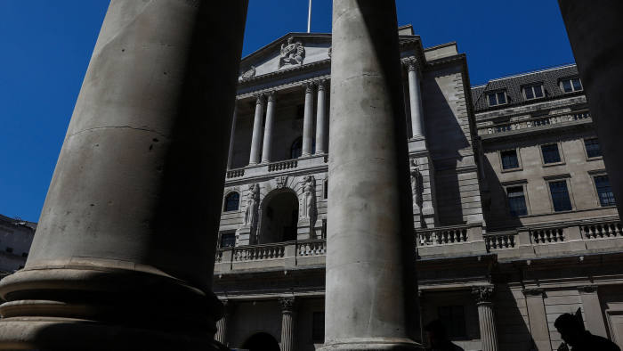 A Union flag, also known as the Union Jack, flies above the Bank of England (BOE) in the City of London, U.K., on Wednesday, June 27, 2018. The BOE stepped up pressure on the European Union to remove the threat that Brexit poses to trillions of pounds of derivative contracts. Photographer: Simon Dawson/Bloomberg