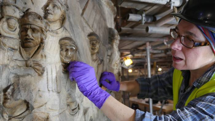 3. Conservator working on Trajan's Column © Victoria and Albert Museum, London Rope Access down inside trajan's column for a condition survey, conservation work around the cast courts, Roofline photography of Cast courts.