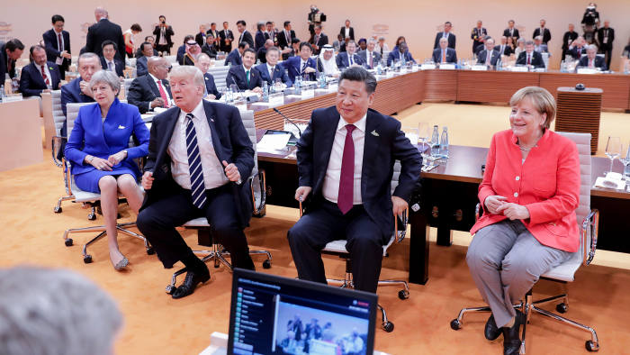 (R-L) German Chancellor Angela Merkel, China's President Xi Jinping, US President Donald Trump, Britain's Prime Minister Theresa May, Turkey's President Recep Tayyip Erdogan, South Africa's President Jacob Zuma and Russia's President Vladimir Putin are pictured at the start of the first working session of the G20 meeting in Hamburg, northern Germany, on July 7. Leaders of the world's top economies will gather from July 7 to 8, 2017 in Germany for likely the stormiest G20 summit in years, with disagreements ranging from wars to climate change and global trade. / AFP PHOTO / POOL / Kay Nietfeld (Photo credit should read KAY NIETFELD/AFP/Getty Images)