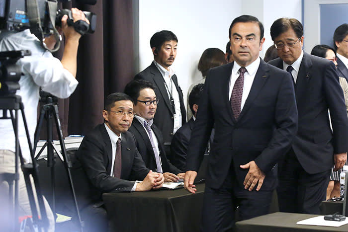 "FILE PHOTO: Carlos Ghosn, then-chief executive officer of Nissan Motor Co., second right, and Osamu Masuko, chairman and chief executive officer of Mitsubishi Motors Corp., right, walk past Hiroto Saikawa, then-chief competitive officer of Nissan Motor Co., seated left, as they arrive at a news conference in Yokohama, Kanagawa Prefecture, Japan, on Thursday, May 12, 2016. Fallen auto titan Carlos Ghosn said in an interview with Japan's Nikkei newspaper published Jan. 30, 2019, that his arrest for alleged financial crimes was the result of a ""plot"" against him by Nissan executives trying to prevent the Japanese carmaker's deeper integration with Renault SA. Photographer: Yuriko Nakao/Bloomberg"