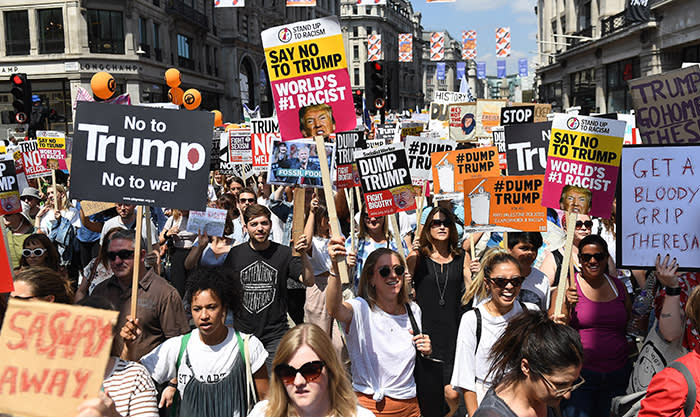 epa06885622 Tens of thousands of people take part in a Stop Trump Coalition - Stop the War Protest against the US President Donal J. Trump visit in London, Britain, 13 July 2018. Trump is on a working visit to Britain. EPA/ANDY RAIN